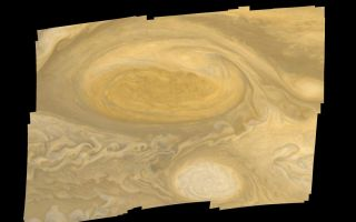 "<h1>PIA00022:  Jupiter Great Red Spot Mosaic</h1><div class=""PIA00022"" lang=""en"" style=""width:800px;text-align:left;margin:auto;background-color:#000;padding:10px;max-height:150px;overflow:auto;"">This photo of Jupiter's Great Red Spot was taken by Voyager 1 in early March 1979. Distance from top to bottom of the picture is 15,000 miles (24,000 kilometers). Smallest features visible are about 20 miles (30 kilometers) across. The white feature below the Great Red Spot is one of several white ovals that were observed to form about 40 years ago; they move around Jupiter at a different velocity from the Red Spot. During the Voyager 1 encounter period, material was observed to revolve around the center of the spot with a period of six days. The Voyager project is managed for NASA's Office of Space Science by the Jet Propulsion Laboratory.<br /><br /><a href=""http://photojournal.jpl.nasa.gov/catalog/PIA00022"" onclick=""window.open(this.href); return false;"" title=""Voir l'image 	 PIA00022:  Jupiter Great Red Spot Mosaic	  sur le site de la NASA"">Voir l'image 	 PIA00022:  Jupiter Great Red Spot Mosaic	  sur le site de la NASA.</a></div>"