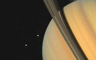"<h1>PIA00024:  Saturn With Tethys and Dione</h1><div class=""PIA00024"" lang=""en"" style=""width:800px;text-align:left;margin:auto;background-color:#000;padding:10px;max-height:150px;overflow:auto;"">Saturn and two of its moons, Tethys (above) and Dione, were photographed by Voyager 1 on November 3, 1980, from 13 million kilometers (8 million miles). The shadows of Saturn's three bright rings and Tethys are cast onto the cloud tops. The limb of the planet can be seen easily through the 3,500-kilometer-wide (2,170 mile) Cassini Division, which separates ring A from ring B. The view through the much narrower Encke Division, near the outer edge of ring A is less clear. Beyond the Encke Division (at left) is the faintest of Saturn's three bright rings, the C-ring or crepe ring, barely visible against the planet. The Voyager Project is managed by the Jet Propulsion Laboratory for NASA.<br /><br /><a href=""http://photojournal.jpl.nasa.gov/catalog/PIA00024"" onclick=""window.open(this.href); return false;"" title=""Voir l'image 	 PIA00024:  Saturn With Tethys and Dione	  sur le site de la NASA"">Voir l'image 	 PIA00024:  Saturn With Tethys and Dione	  sur le site de la NASA.</a></div>"
