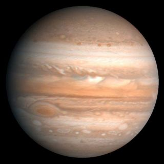 "<h1>PIA00343:  Jupiter</h1><div class=""PIA00343"" lang=""en"" style=""width:800px;text-align:left;margin:auto;background-color:#000;padding:10px;max-height:150px;overflow:auto;"">This processed color image of Jupiter was produced in 1990 by the U.S. Geological Survey from a Voyager image captured in 1979. The colors have been enhanced to bring out detail. Zones of light-colored, ascending clouds alternate with bands of dark, descending clouds. The clouds travel around the planet in alternating eastward and westward belts at speeds of up to 540 kilometers per hour. Tremendous storms as big as Earthly continents surge around the planet. The Great Red Spot (oval shape toward the lower-left) is an enormous anticyclonic storm that drifts along its belt, eventually circling the entire planet.<br /><br /><a href=""http://photojournal.jpl.nasa.gov/catalog/PIA00343"" onclick=""window.open(this.href); return false;"" title=""Voir l'image 	 PIA00343:  Jupiter	  sur le site de la NASA"">Voir l'image 	 PIA00343:  Jupiter	  sur le site de la NASA.</a></div>"