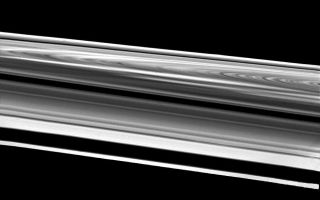 "<h1>PIA00534:  Wide-Angle Image of Saturn's Rings</h1><div class=""PIA00534"" lang=""en"" style=""width:800px;text-align:left;margin:auto;background-color:#000;padding:10px;max-height:150px;overflow:auto;"">This wide-angle image of Saturn's rings was taken Aug. 26 just before Voyager 2's crossing of the plane of these complex structures. The spacecraft was 103,000 kilometers (64,000 miles) from the rings when it acquired this image. This extremely oblique view of the bright side of the rings highly magnifies features near the bottom of the picture and compresses features across to the other side of the west ansa (the western edge of the loop in the rings). Starting from the bottom, one can see the F-ring, the A-ring with the Encke Gap, the Cassini Division (the narrow dark band at center), the B-ring and the C-ring. The high-contrast bright and dark areas of the C-ring are seen at right; then, continuing upward, come the B- and A-rings straddling the Cassini Division and a very foreshortened view of the A-ring. The bright streaks in the B-ring are the spokes in forward-scattered light. The Voyager project is managed for NASA by the Jet Propulsion Laboratory, Pasadena, Calif.<br /><br /><a href=""http://photojournal.jpl.nasa.gov/catalog/PIA00534"" onclick=""window.open(this.href); return false;"" title=""Voir l'image 	 PIA00534:  Wide-Angle Image of Saturn's Rings	  sur le site de la NASA"">Voir l'image 	 PIA00534:  Wide-Angle Image of Saturn's Rings	  sur le site de la NASA.</a></div>"