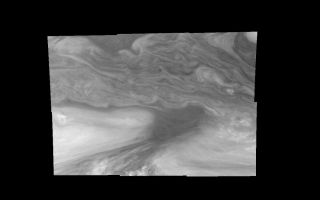 "<h1>PIA01210:  Jupiter's Equatorial Region in a Methane band (Time set 4)</h1><div class=""PIA01210"" lang=""en"" style=""width:800px;text-align:left;margin:auto;background-color:#000;padding:10px;max-height:150px;overflow:auto;"">Mosaic of Jupiter's equatorial region at 727 nanometers (nm). The mosaic covers an area of 34,000 kilometers by 22,000 kilometers. Light at 727 nm is moderately absorbed by atmospheric methane. This image shows the features of Jupiter's main visible cloud deck and upper-tropospheric haze, with higher features enhanced in brightness over lower features. The dark region near the center of the mosaic is an equatorial ""hotspot"" similar to the Galileo Probe entry site. These features are holes in the bright, reflective, equatorial cloud layer where warmer thermal emission from Jupiter's deep atmosphere can pass through. The circulation patterns observed here along with the composition measurements from the Galileo Probe suggest that dry air may be converging and sinking over these regions, maintaining their cloud-free appearance. The bright oval in the upper right of the mosaic as well as the other smaller bright features are examples of upwelling of moist air and condensation.<p>North is at the top. The mosaic covers latitudes 1 to 19 degrees and is centered at longitude 336 degrees West. The smallest resolved features are tens of kilometers in size. These images were taken on December 17, 1996, at a range of 1.5 million kilometers by the Solid State Imaging system aboard NASA's Galileo spacecraft.<p>The Jet Propulsion Laboratory, Pasadena, CA manages the mission for NASA's Office of Space Science, Washington, DC.<p>This image and other images and data received from Galileo are posted on the World Wide Web, on the Galileo mission home page at URL http://galileo.jpl.nasa.gov. Background information and educational context for the images can be found at <a href=""http://www2.jpl.nasa.gov/galileo/sepo/"" target=""_blank"">http://www.jpl.nasa.gov/galileo/sepo</a>..<br /><br /><a href=""http://photojournal.jpl.nasa.gov/catalog/PIA01210"" onclick=""window.open(this.href); return false;"" title=""Voir l'image 	 PIA01210:  Jupiter's Equatorial Region in a Methane band (Time set 4)	  sur le site de la NASA"">Voir l'image 	 PIA01210:  Jupiter's Equatorial Region in a Methane band (Time set 4)	  sur le site de la NASA.</a></div>"