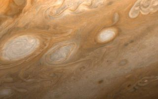 "<h1>PIA01513:  Jupiter - Southeast of Great Red Spot</h1><div class=""PIA01513"" lang=""en"" style=""width:800px;text-align:left;margin:auto;background-color:#000;padding:10px;max-height:150px;overflow:auto;"">This photo of Jupiter was taken by Voyager 1 on March 1, 1979, from a distance of 2.7 million miles (4.3 million kilometers). The region shown is just to the southeast of the Great Red Spot. A small section of the spot can be seen at upper left. One of the 40-year-old white ovals in Jupiter's atmosphere can also be seen at middle left, as well as a wealth of other atmospheric features, including the flow lines in and around the ovals. The smallest details that can be seen in this photo are about 45 miles (80 kilometers) across. JPL manages and controls the Voyager project for NASA's Office of Space Science.<br /><br /><a href=""http://photojournal.jpl.nasa.gov/catalog/PIA01513"" onclick=""window.open(this.href); return false;"" title=""Voir l'image 	 PIA01513:  Jupiter - Southeast of Great Red Spot	  sur le site de la NASA"">Voir l'image 	 PIA01513:  Jupiter - Southeast of Great Red Spot	  sur le site de la NASA.</a></div>"