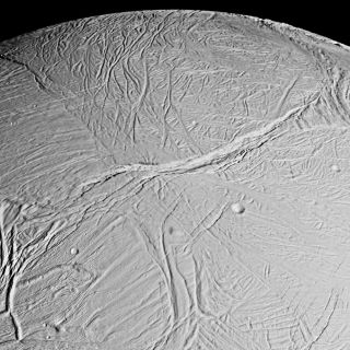 "<h1>PIA06191:  Enceladus Mosaic</h1><div class=""PIA06191"" lang=""en"" style=""width:800px;text-align:left;margin:auto;background-color:#000;padding:10px;max-height:150px;overflow:auto;""><p><a href=""/figures/PIA06191_fig1.jpg""></a><br>Figure 1: Originally Released Image</p><p>This spectacular view is a mosaic of four high resolution images taken by the Cassini spacecraft narrow angle camera on Feb. 16, 2005, during its close flyby of Saturn's moon Enceladus.</p><p>The view is about 300 kilometers (200 miles) across and shows the myriad of faults, fractures, folds, troughs and craters that make this Saturnian satellite especially intriguing to planetary scientists. More than 20 years ago, NASA's Voyager spacecraft gave hints of a surface cut by tectonic features, and subsequent images of other icy moons have revealed many different ways that stresses have acted on icy moon crusts.</p><p>The new close-up images of Enceladus, which has a diameter of 505 kilometers (314 miles), show some familiar-looking features and others that are brand new. The work required to unravel their origins, their formation sequence, and the implications for the evolution of icy solar system bodies is just beginning.</p><p>Voyager images of Enceladus, which were obtained at much poorer spatial resolution, showed terrains like those seen here. They were called ""smooth plains"" because they appeared to exhibit little topographic relief. However, Cassini has now viewed these terrains at almost 10 times better resolution. The new images reveal very complex systems of fractures, resurfaced terrain, and in some cases, topographic relief greater than several hundred meters. </p><p>Many styles of fracturing are evident in this mosaic. Extending downward from the top center of the mosaic for hundreds of kilometers is a broad belt of complex, interwoven fractures. A huge rift 5 kilometers (3 miles)-wide dissects this belt and extends into several older-looking, distinct regions or ""cells"" of terrain that themselves exhibit distinct fracture patterns.<p>Because Cassini flew rapidly past Enceladus, the right-side images were taken from a slightly different perspective than the left, and are delineated by the white box.</p><p>The mosaic covers longitudes from about 254 west to 296 west and latitudes from 60 south to the equator.</p><p>The images were taken in visible light on Feb. 17, 2005, at distances ranging from of 26,140 to 17,434 kilometers (16,243 to 10,833 miles) from Enceladus and at Sun-Enceladus-spacecraft, or phase, angles ranging from 27 to 29 degrees. Pixel scale in the left-side image is 150 meters (492 feet) per pixel; in the right-side (white box) image, scale is 105 meters (344 feet) per pixel. The image has been contrast-enhanced to aid visibility. </p><p>The Cassini-Huygens mission is a cooperative project of NASA, the European Space Agency and the Italian Space Agency. The Jet Propulsion Laboratory, a division of the California Institute of Technology in Pasadena, manages the mission for NASA's Science Mission Directorate, Washington, D.C. The Cassini orbiter and its two onboard cameras were designed, developed and assembled at JPL. The imaging team is based at the Space Science Institute, Boulder, Colo.</p><p>For more information about the Cassini-Huygens mission, visit <a href=""http://saturn.jpl.nasa.gov"">http://saturn.jpl.nasa.gov</a> and the Cassini imaging team home page, <a href=""http://ciclops.org"">http://ciclops.org</a>.</p><br /><br /><a href=""http://photojournal.jpl.nasa.gov/catalog/PIA06191"" onclick=""window.open(this.href); return false;"" title=""Voir l'image 	 PIA06191:  Enceladus Mosaic	  sur le site de la NASA"">Voir l'image 	 PIA06191:  Enceladus Mosaic	  sur le site de la NASA.</a></div>"