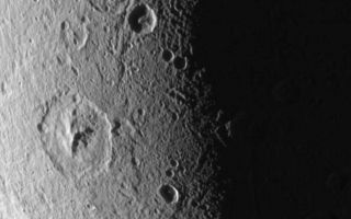 "<h1>PIA07692:  Dione: Magnified View</h1><div class=""PIA07692"" lang=""en"" style=""width:800px;text-align:left;margin:auto;background-color:#000;padding:10px;max-height:150px;overflow:auto;""><p>This close-up of Dione's icy surface shows deeply shadowed craters near the terminator, as well as a group of roughly linear faults above center.</p><p>The terrain shown here is on the moon's leading hemisphere. North on Dione (1,126 kilometers, or 700 miles across) is up and tilted 21 degrees to the right.</p><p>The image was taken in visible green light with the Cassini spacecraft narrow-angle camera on Dec. 24, 2005 at a distance of approximately 152,000 kilometers (94,000 miles) from Dione and at a Sun-Dione-spacecraft, or phase, angle of 109 degrees. Resolution in the original image was 904 meters (2,965 feet) per pixel. The image has been magnified by a factor of two and contrast-enhanced to aid visibility.</p><p>The Cassini-Huygens mission is a cooperative project of NASA, the European Space Agency and the Italian Space Agency. The Jet Propulsion Laboratory, a division of the California Institute of Technology in Pasadena, manages the mission for NASA's Science Mission Directorate, Washington, D.C. The Cassini orbiter and its two onboard cameras were designed, developed and assembled at JPL. The imaging operations center is based at the Space Science Institute in Boulder, Colo.</p><p>For more information about the Cassini-Huygens mission visit <a href=""http://saturn.jpl.nasa.gov"">http://saturn.jpl.nasa.gov</a>. The Cassini imaging team homepage is at <a href=""http://ciclops.org"">http://ciclops.org</a>.</p><br /><br /><a href=""http://photojournal.jpl.nasa.gov/catalog/PIA07692"" onclick=""window.open(this.href); return false;"" title=""Voir l'image 	 PIA07692:  Dione: Magnified View	  sur le site de la NASA"">Voir l'image 	 PIA07692:  Dione: Magnified View	  sur le site de la NASA.</a></div>"
