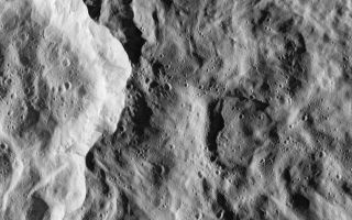 "<h1>PIA07764:  Catch that Crater</h1><div class=""PIA07764"" lang=""en"" style=""width:800px;text-align:left;margin:auto;background-color:#000;padding:10px;max-height:150px;overflow:auto;""><p>In the nick of time, the Cassini spacecraft snapped this image of the eastern rim of Saturn's moon Rhea's bright, ray crater. The impact event appears to have made a prominent bright splotch on the leading hemisphere of Rhea (see <a href=""/catalog/PIA06648"">PIA06648</a>). Because Cassini was traveling so fast relative to Rhea as the flyby occurred, the crater would have been out of the camera's field of view in any earlier or later exposure.</p><p>The crater's total diameter is about 50 kilometers (30 miles), but this rim view shows details of terrains both interior to the crater and outside its rim. The prominent bright scarp, left of the center, is the crater wall, and the crater interior is to the left of the scarp. The exterior of the crater (right of the scarp) is characterized by softly undulating topography and gentle swirl-like patterns that formed during the emplacement of the large crater's continuous blanket of ejecta material.</p><p>Numerous small craters conspicuously pepper the larger crater's floor and much of the area immediately outside of it. However, in some places, such as terrain in the top portion of the image and the bright crater wall, the terrain appears remarkably free of the small impacts. The localized ""shot pattern"" and non-uniform distribution of these small craters indicate that they are most likely secondary impacts -- craters formed from fallback material excavated from a nearby primary impact site. Because they exist both inside and outside the large crater in this image, the source impact of the secondary impacts must have happened more recently than the impact event that formed the large crater in this scene.</p><p>This is one of the highest-resolution images of Rhea's surface obtained during Cassini's very close flyby on Nov. 26, 2005, during which the spacecraft swooped to within 500 kilometers (310 miles) of the large moon. Rhea is 1,528 kilometers (949 miles) across and is Saturn's second largest moon, after planet-sized Titan.</p><p>The clear filter image was acquired with the wide-angle camera at an altitude of 511 kilometers (317 miles) above Rhea. Image scale is about 34 meters (112 feet) per pixel. </p><p>The Cassini-Huygens mission is a cooperative project of NASA, the European Space Agency and the Italian Space Agency. The Jet Propulsion Laboratory, a division of the California Institute of Technology in Pasadena, manages the mission for NASA's Science Mission Directorate, Washington, D.C. The Cassini orbiter and its two onboard cameras were designed, developed and assembled at JPL. The imaging operations center is based at the Space Science Institute in Boulder, Colo.</p></p>For more information about the Cassini-Huygens mission visit <a href=""http://saturn.jpl.nasa.gov"">http://saturn.jpl.nasa.gov</a>. The Cassini imaging team homepage is at <a href=""http://ciclops.org"">http://ciclops.org</a>.</p><br /><br /><a href=""http://photojournal.jpl.nasa.gov/catalog/PIA07764"" onclick=""window.open(this.href); return false;"" title=""Voir l'image 	 PIA07764:  Catch that Crater	  sur le site de la NASA"">Voir l'image 	 PIA07764:  Catch that Crater	  sur le site de la NASA.</a></div>"