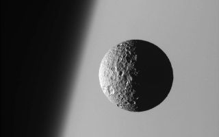 "<h1>PIA08172:  Sharp Focus on Mimas</h1><div class=""PIA08172"" lang=""en"" style=""width:800px;text-align:left;margin:auto;background-color:#000;padding:10px;max-height:150px;overflow:auto;""><p>This amazing perspective view captures battered Mimas against the hazy limb of Saturn.</p><p>It is obvious in such close-up images that Mimas (397 kilometers, or 247 miles across) has been badly scarred by impacts over the eons. Its 130 kilometer- (80 mile-) wide crater, Herschel, lies in the darkness at right.</p><p>North on Mimas is up and rotated 19 degrees to the right.</p><p>The image was taken with the Cassini spacecraft narrow-angle camera on March 21, 2006 using a filter sensitive to wavelengths of ultraviolet light centered at 338 nanometers. The image was acquired at a distance of approximately 191,000 kilometers (119,000 miles) from Mimas and at a Sun-Mimas-spacecraft, or phase, angle of 91 degrees. Image scale is 1 kilometer (3,730 feet) per pixel.</p><p>The Cassini-Huygens mission is a cooperative project of NASA, the European Space Agency and the Italian Space Agency. The Jet Propulsion Laboratory, a division of the California Institute of Technology in Pasadena, manages the mission for NASA's Science Mission Directorate, Washington, D.C. The Cassini orbiter and its two onboard cameras were designed, developed and assembled at JPL. The imaging operations center is based at the Space Science Institute in Boulder, Colo.</p><p>For more information about the Cassini-Huygens mission visit <a href=""http://saturn.jpl.nasa.gov"">http://saturn.jpl.nasa.gov/home/index.cfm</a>. The Cassini imaging team homepage is at <a href=""http://ciclops.org"">http://ciclops.org</a>.</p><br /><br /><a href=""http://photojournal.jpl.nasa.gov/catalog/PIA08172"" onclick=""window.open(this.href); return false;"" title=""Voir l'image 	 PIA08172:  Sharp Focus on Mimas	  sur le site de la NASA"">Voir l'image 	 PIA08172:  Sharp Focus on Mimas	  sur le site de la NASA.</a></div>"