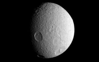 "<h1>PIA09723:  History on Tethys</h1><div class=""PIA09723"" lang=""en"" style=""width:689px;text-align:left;margin:auto;background-color:#000;padding:10px;max-height:150px;overflow:auto;""><p>The Cassini spacecraft spies four large impact basins on the southern hemisphere of icy Tethys.</p><p>Tethys (1,071 kilometers, or 665 miles across), like the other airless worlds of the Solar System, wears the record of countless impacts experienced over the eons.</p><p>Lit terrain seen here is on the leading hemisphere of Tethys. North is up and rotated 15 degrees to the left.</p><p>The image was taken in visible light with the Cassini spacecraft narrow-angle camera on July 21, 2007. The view was obtained at a distance of approximately 452,000 kilometers (281,000 miles) from Tethys and at a Sun-Tethys-spacecraft, or phase, angle of 54 degrees. Image scale is 3 kilometers (2 miles) per pixel.</p><p>The Cassini-Huygens mission is a cooperative project of NASA, the European Space Agency and the Italian Space Agency.  The Jet Propulsion Laboratory, a division of the California Institute of Technology in Pasadena, manages the mission for NASA's Science Mission Directorate, Washington, D.C. The Cassini orbiter and its two onboard cameras were designed, developed and assembled at JPL.  The imaging operations center is based at the Space Science Institute in Boulder, Colo.</p><p>For more information about the Cassini-Huygens mission visit <a href=""http://saturn.jpl.nasa.gov"">http://saturn.jpl.nasa.gov/home/index.cfm</a>. The Cassini imaging team homepage is at <a href=""http://ciclops.org"">http://ciclops.org</a>.</p><br /><br /><a href=""http://photojournal.jpl.nasa.gov/catalog/PIA09723"" onclick=""window.open(this.href); return false;"" title=""Voir l'image 	 PIA09723:  History on Tethys	  sur le site de la NASA"">Voir l'image 	 PIA09723:  History on Tethys	  sur le site de la NASA.</a></div>"
