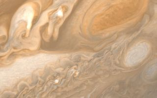 "<h1>PIA00359:  Jupiter Great Red Spot and White Ovals</h1><div class=""PIA00359"" lang=""en"" style=""width:800px;text-align:left;margin:auto;background-color:#000;padding:10px;max-height:150px;overflow:auto;"">This photo of Jupiter was taken by Voyager 1 on March 1, 1979. The spacecraft was 3 million miles (5 million kilometers) from Jupiter at the time. The photo shows Jupiter's Great Red Spot (upper right) and the turbulent region immediately to the west. At the middle right of the frame is one of several white ovals seen on Jupiter from Earth. The structure in every feature here is far better than has ever been seen from any telescopic observations. The Red Spot and the white oval both reveal intricate and involved structure. The smallest details that can be seen in this photo are about 55 miles (95 kilometers) across. JPL manages and controls the Voyager project for NASA's Office of Space Science.<br /><br /><a href=""http://photojournal.jpl.nasa.gov/catalog/PIA00359"" onclick=""window.open(this.href); return false;"" title=""Voir l'image 	 PIA00359:  Jupiter Great Red Spot and White Ovals	  sur le site de la NASA"">Voir l'image 	 PIA00359:  Jupiter Great Red Spot and White Ovals	  sur le site de la NASA.</a></div>"