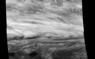 "<h1>PIA00843:  Jupiter's Belt-Zone Boundary (Methane filter, 732 nm)</h1><div class=""PIA00843"" lang=""en"" style=""width:800px;text-align:left;margin:auto;background-color:#000;padding:10px;max-height:150px;overflow:auto;"">Mosaic of a belt-zone boundary near Jupiter's equator. The images that make up the four quadrants of this mosaic were taken within a few minutes of each other and show Jupiter's appearance at 732 nanometers (nm). Sunlight at 732 nm is weakly absorbed by atmospheric methane. This absorption lowers the total amount of scattered light detected by the Galileo spacecraft while enhancing the fraction that comes from higher in Jupiter's atmosphere where less methane is present. The features of the lower ammonia cloud deck that are seen at 756 nm remain visible, but features in the higher, diffuse cloud are made more apparent.<p>The bowed shape of the clouds in the center of the image is created by a combination of stretching in the eastward direction by strong winds and stretching in the north-south direction by weaker winds. The precise shape of the bow and the eastward wind speeds can be measured. The north-south wind speeds, too small to be directly measured, then can be calculated. These images may provide the first indirect measurement of Jupiter's north-south winds.<p>The Jet Propulsion Laboratory, Pasadena, CA manages the mission for NASA's Office of Space Science, Washington, DC.<p>This image and other images and data received from Galileo are posted on the World Wide Web, on the Galileo mission home page at URL http://galileo.jpl.nasa.gov. Background information and educational context for the images can be found at <a href=""http://www2.jpl.nasa.gov/galileo/sepo/"" target=""_blank"">http://www.jpl.nasa.gov/galileo/sepo</a>..<br /><br /><a href=""http://photojournal.jpl.nasa.gov/catalog/PIA00843"" onclick=""window.open(this.href); return false;"" title=""Voir l'image 	 PIA00843:  Jupiter's Belt-Zone Boundary (Methane filter, 732 nm)	  sur le site de la NASA"">Voir l'image 	 PIA00843:  Jupiter's Belt-Zone Boundary (Methane filter, 732 nm)	  sur le site de la NASA.</a></div>"