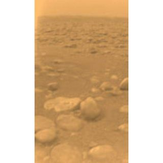 "<h1>PIA07232:  First Color View of Titan's Surface</h1><div class=""PIA07232"" lang=""en"" style=""width:546px;text-align:left;margin:auto;background-color:#000;padding:10px;max-height:150px;overflow:auto;""><p>This image was returned yesterday, January 14, 2005, by the European Space Agency's Huygens probe during its successful descent to land on Titan. This is the colored view, following processing to add reflection spectra data, and gives a better indication of the actual color of the surface. </p><p>Initially thought to be rocks or ice blocks, they are more pebble-sized. The two rock-like objects just below the middle of the image are about 15 centimeters (about 6 inches) (left) and 4 centimeters (about 1.5 inches) (center) across respectively, at a distance of about 85 centimeters (about 33 inches) from Huygens. The surface is darker than originally expected, consisting of a mixture of water and hydrocarbon ice. There is also evidence of erosion at the base of these objects, indicating possible fluvial activity.                                                                                      </p><p>                 The image was taken with the Descent Imager/Spectral Radiometer, one of two NASA instruments on the probe.</p><p>The Cassini-Huygens mission is a cooperative project of NASA, the European Space Agency and the Italian Space Agency.  The Jet Propulsion Laboratory, a division of the California Institute of Technology in Pasadena, manages the Cassini-Huygens mission for NASA's Science Mission Directorate, Washington, D.C. The Cassini orbiter and its two onboard cameras were designed, developed and assembled at JPL.  The Descent Imager/Spectral team is based at the University of Arizona, Tucson, Ariz.For more information about the Cassini-Huygens mission visit  <a href=""http://saturn.jpl.nasa.gov/home/index.cfm"">http://saturn.jpl.nasa.gov/home/index.cfm</a>. </p><br /><br /><a href=""http://photojournal.jpl.nasa.gov/catalog/PIA07232"" onclick=""window.open(this.href); return false;"" title=""Voir l'image 	 PIA07232:  First Color View of Titan's Surface	  sur le site de la NASA"">Voir l'image 	 PIA07232:  First Color View of Titan's Surface	  sur le site de la NASA.</a></div>"